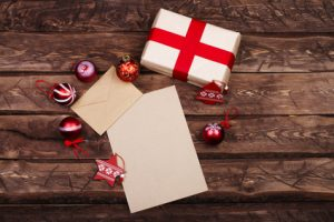 Envelope on wooden background with Christmas decorations